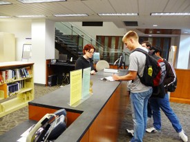 Foster Library Information Desk with Students