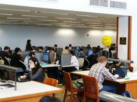 Foster Library Students Studying and Happy Face Baloon