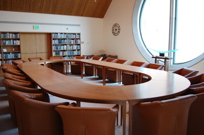 View of the conference table in the Donald E. Petersen Room, located on the 4th floor of the Allen Library, looking N towards round window.